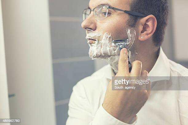 Shaving razor, young man
