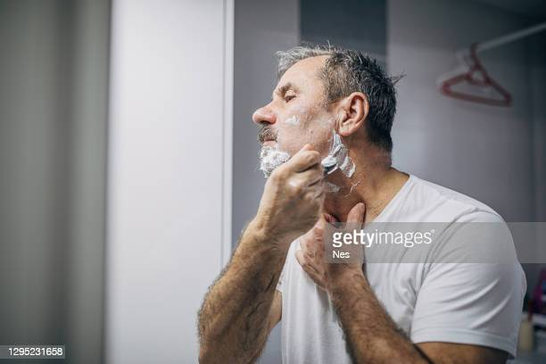 shaving the beard - shaved stock pictures, royalty-free photos & images