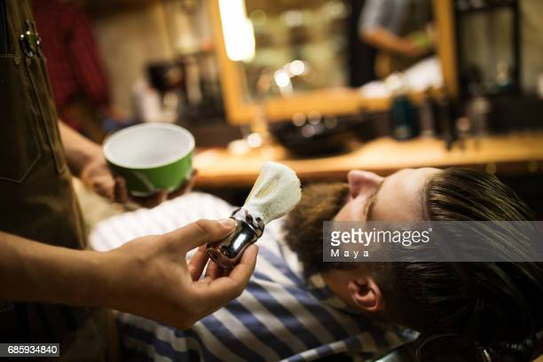 Shaving time at barber shop