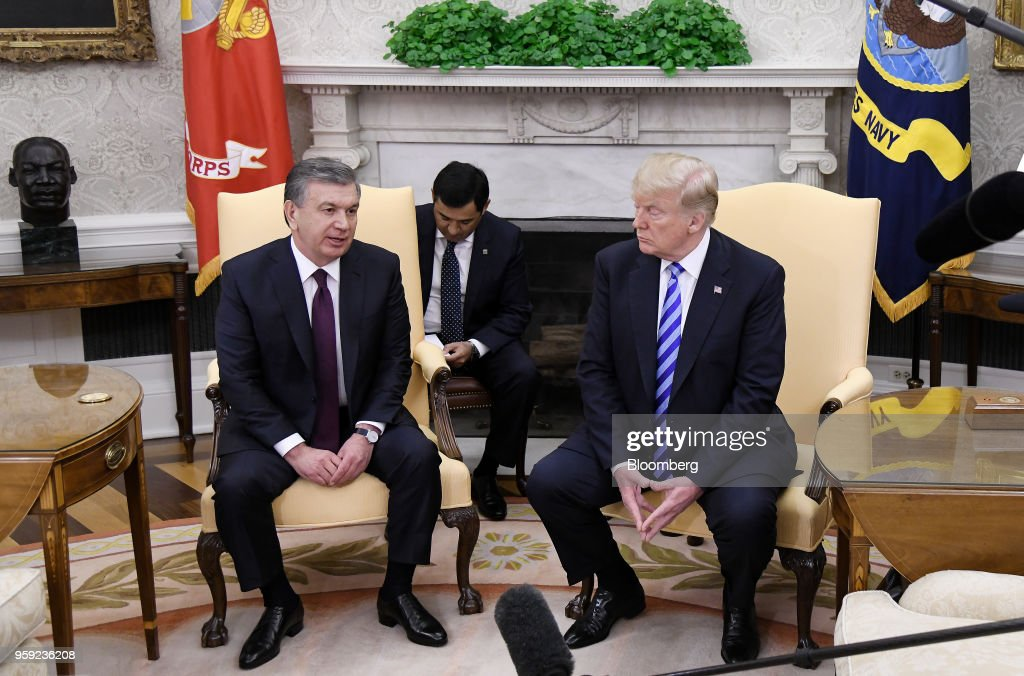 Shavkat Mirziyoev, Uzbekistan's president, left, speaks during as U.S. President Donald Trump listens during a meeting in the Oval Office of the White House in Washington, D.C., U.S., on Wednesday, May 16, 2018. Trump said he is working closely with Mirziyoev while discussing trade and military equipment. Photographer: Olivier Douliery/Pool via Bloomberg