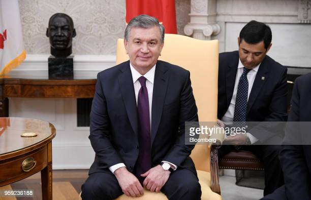 Shavkat Mirziyoev Uzbekistan's president listens during a meeting with US President Donald Trump in the Oval Office of the White House in Washington...