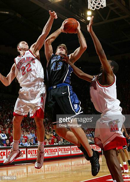 Shavlik Randolph of the Duke Blue Devils gets off a shot between Nik CanerMedley and Travis Garrison of the Maryland Terrapins during ACC basketball...