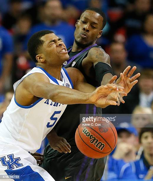 Shavon Coleman of the LSU Tigers fouls Andrew Harrison of the Kentucky Wildcats during the quarterfinals of the SEC Men's Basketball Tournament at...