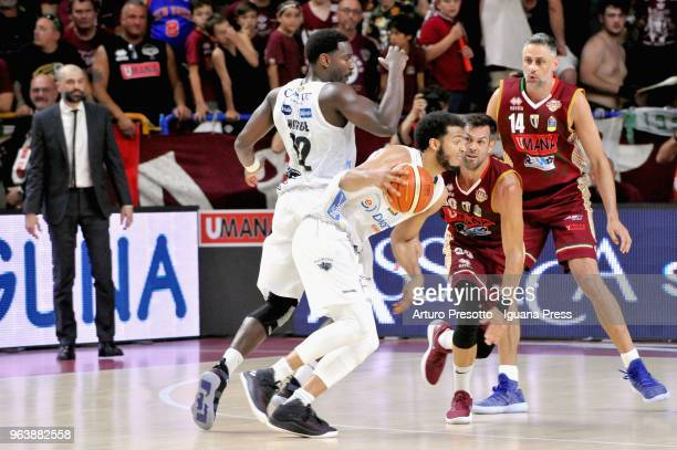 Shavon Shields and Dustin Hogue of Dolomiti Energia competes with Bruno Cerella and Tomas Ress of Umana during the LBA Legabasket of Serie A match...
