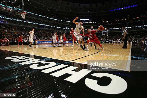 Shavon Shields of the Nebraska Cornhuskers handles the ball next to AJ Hammons of the Purdue Boilermakers during a first round game of the Big Ten...