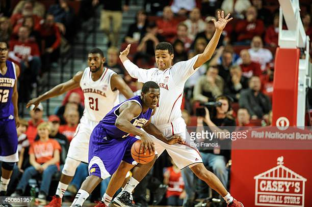 Shavon Shields of the Nebraska Cornhuskers is guarded by Adam Link of the Western Illinois Leathernecks during their game at Pinnacle Bank Arena on...