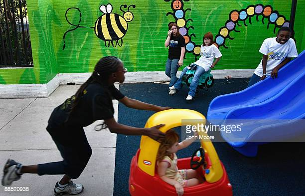 Shavonta Tripplett, age 10, pushes Hailey Morris, age 3, in a playground at the Family Gateway family homeless shelter on June 15, 2009 in Dallas,...