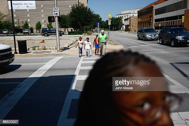 Shavonta Tripplett, age 10, waits for fellow homeless children at an intersection on June 15, 2009 in Dallas, Texas. More than 50 children currently...