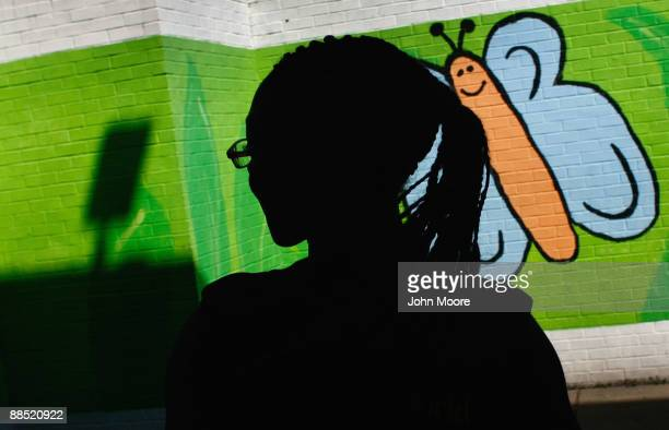 Shavonta Tripplett, age 10, waits stands in the playground of the Family Gateway family homeless shelter on June 15, 2009 in Dallas, Texas. More than...