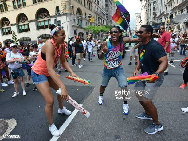 Shavonte Zellous and Kiah Stokes of the New York Liberty dance with Bill Kennedy in the NYC Pride Parade on June 25 2017 in New York City New York...