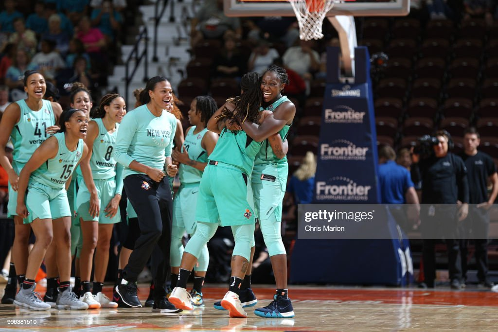 Shavonte Zellous #1 hugs Tina Charles #31 of the New York Liberty after hitting the game winning shot against the Connecticut Sun on July 11, 2018 at the Mohegan Sun Arena in Uncasville, Connecticut.