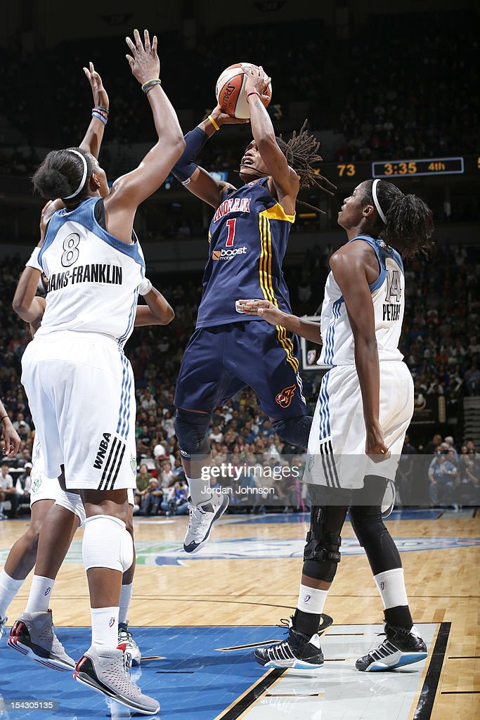 Shavonte Zellous #1 of the Indiana Fever attempts to shoot the ball against Taj McWilliams-Franklin #8 of the Minnesota Lynx during the 2012 WNBA Finals Game Two on October 17, 2012 at Target Center in Minneapolis, Minnesota.