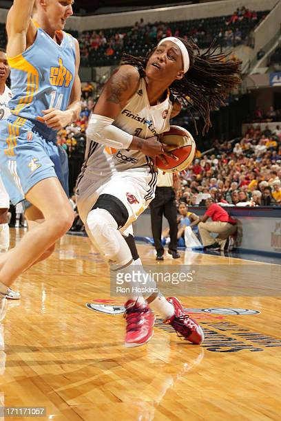 Shavonte Zellous of the Indiana Fever drives on Allie Quigley of the Chicago Sky on June 22 2013 at Bankers Life Fieldhouse in Indianapolis Indiana...