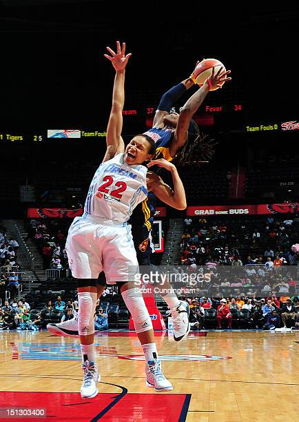 Shavonte Zellous of the Indiana Fever grabs a rebound against Armintie Price of the Atlanta Dream at Philips Arena on September 5 2012 in Atlanta...