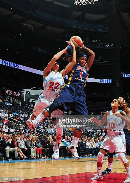Shavonte Zellous of the Indiana Fever grabs a rebound against Armintie Price of the Atlanta Dream during Game 2 of the Eastern Conference SemiFinals...