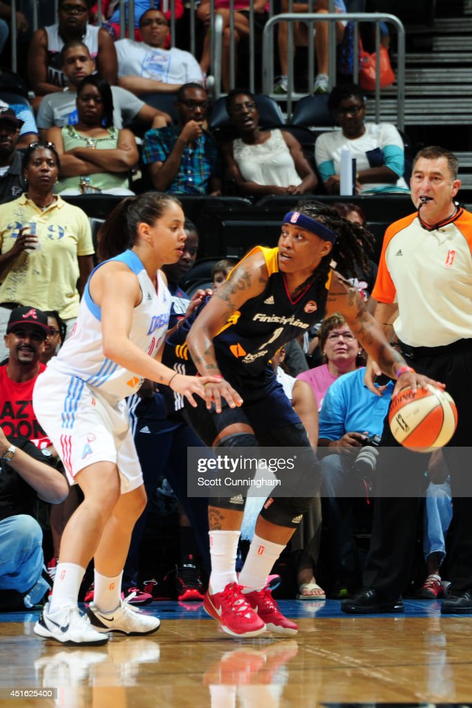 Shavonte Zellous #1 of the Indiana Fever handles the ball against the Atlanta Dream on July 1, 2014 at Philips Arena in Atlanta, Georgia.