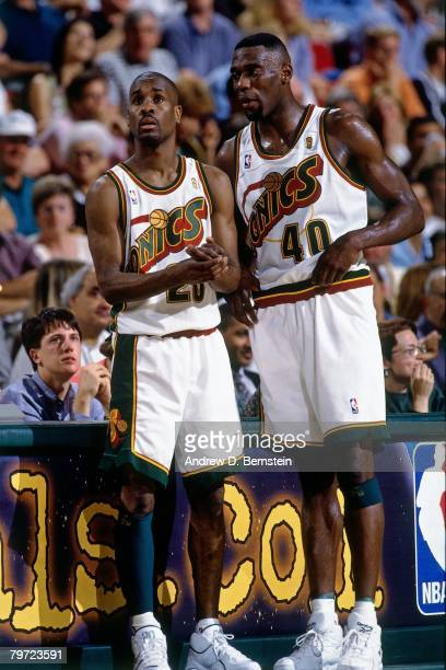 Shaw Kemp and Gary Payton of the Seattle SuperSonics discuss strategy against the Chicago Bulls in Game Five of the 1996 NBA Finals at Key Arena on...