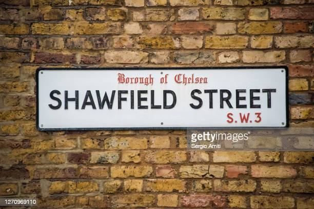 shawfield street sign on brick wall - sign stock pictures, royalty-free photos & images