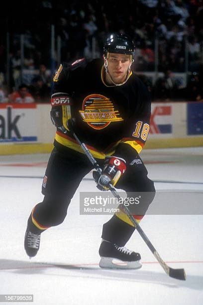 Shawn Antoski of the Vancouver Canucks looks for a pass during a hockey game against the Washington Capitals on November 5 1993 at the USAir Arena in...