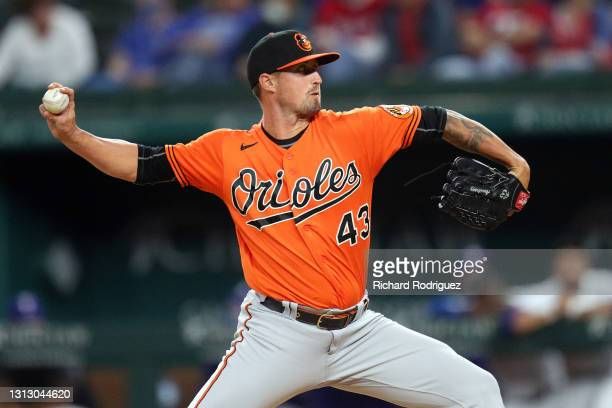 Shawn Armstrong of the Baltimore Orioles pitches against the Texas Rangers in the ninth inning of the MLB game at Globe Life Field on April 17, 2021...