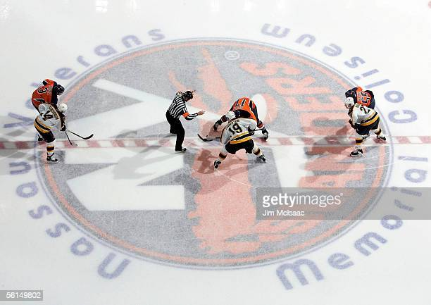 Shawn Bates of the New York Islanders and Joe Thornton of the Boston Bruins take the opening face off in the third period of their game on November...