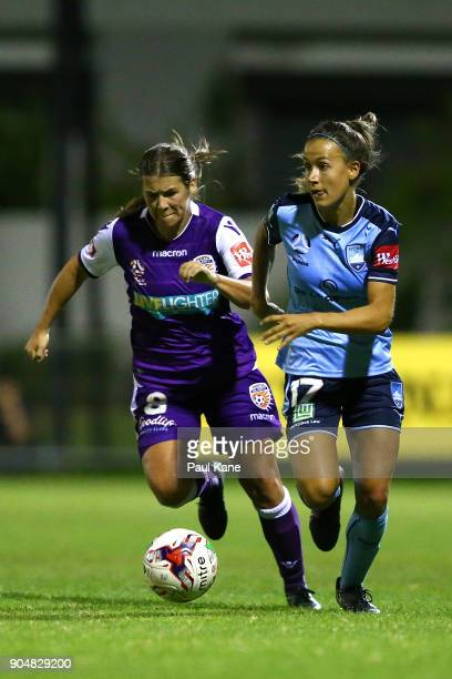 Shawn Billam of the Perth Glory and Angelique Hristodoulou of Sydney contest for the ball during the round 11 WLeague match between the Perth Glory...