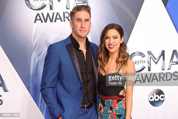 Shawn Booth and Kaitlyn Bristowe attend the 49th annual CMA Awards at the Bridgestone Arena on November 4 2015 in Nashville Tennessee