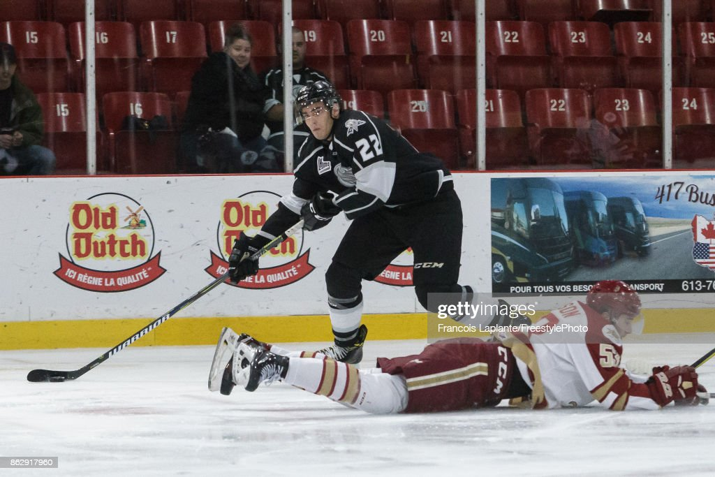 Shawn Boudrias #22 of the Gatineau Olympiques controls the puck and looks at his options as Noah Dobson #53 of the Acadie-Bathurst Titan dives on the ice on October 18, 2017 at Robert Guertin Arena in Gatineau, Quebec, Canada.