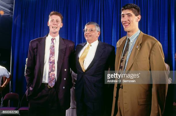 Shawn Bradley, number two overall pick by the Philadelphia 76ers, and Gheorge Muresan pose for a photo with NBA Commissioner, David Stern during the...