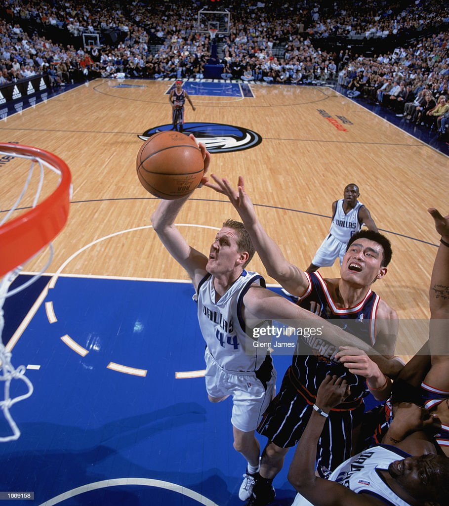 Shawn Bradley #44 of the Dallas Mavericks covered by Yao Ming #11 of the Houston Rockets goes up for the shot during the game at American Airlines Center on November 21, 2002 in Dallas, Texas. The Mavericks defeated the Rockets 103-90.