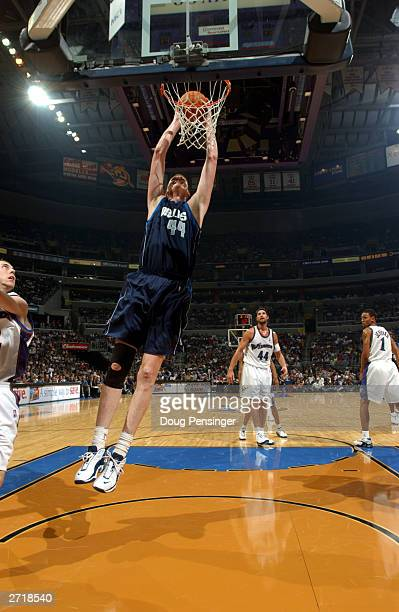 Shawn Bradley of the Dallas Mavericks dunks against the Washington Wizards during the game at the MCI Center on November 5 2003 in Washington DC The...