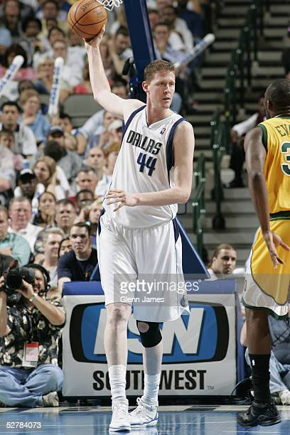 Shawn Bradley of the Dallas Mavericks looks to move the ball against the Seattle SuperSonics during the game at American Airlines Arena on April 19...