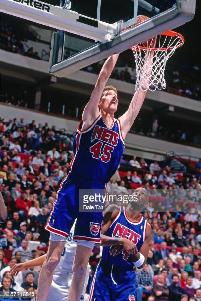 Shawn Bradley of the New Jersey Nets dunks the ball against the Minnesota Timberwolves on January 20 1996 at the Brendan Byrne Arena in East...