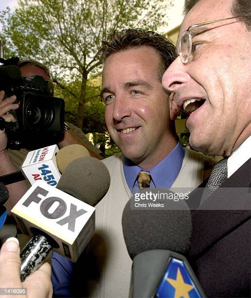 Shawn Brown exhusband of Erin Brockovich and defendant in the Erin Brockovich Extortion case center and his attorney Joel Isaacson right are beseiged...