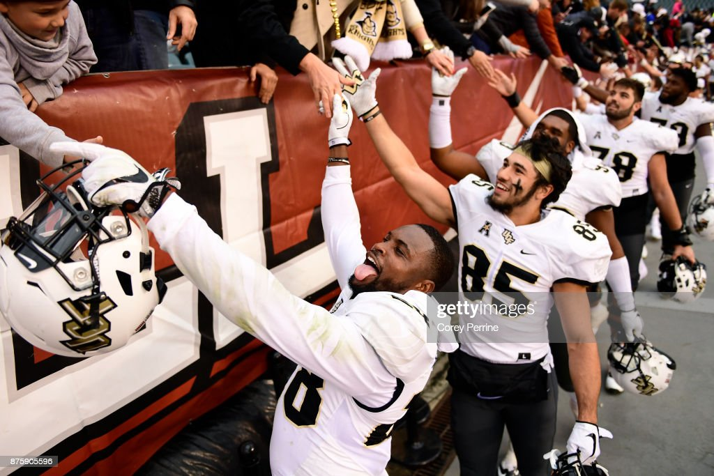 Shawn Burgess-Becker #28 of the UCF Knights hangs his tongue out while high-fiving fans after the win at Lincoln Financial Field on November 18, 2017 in Philadelphia, Pennsylvania. UCF defeated Temple 45-19.