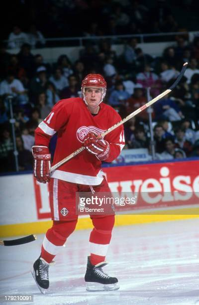 Shawn Burr of the Detroit Red Wings skates on the ice during an NHL game against the New York Islanders on 1990 at the Nassau Coliseum in Uniondale,...