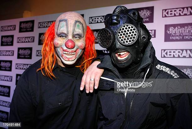 Shawn Crahan and Sid Wilson of Slipknot pose in the winners room at The Kerrang Awards at the Troxy on June 13 2013 in London England