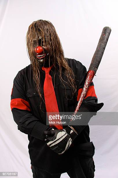 Shawn Crahan of Slipknot poses for a studio portrait session holding a baseball bat backstage at the Download Festival Donington Park Leicestershire...