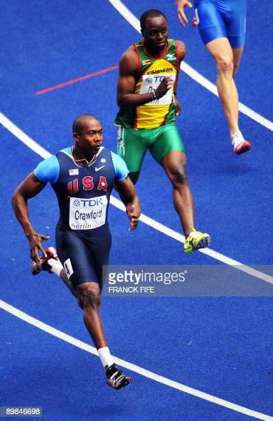 US Shawn Crawford and Zimbabwe's Brian Dzingai compete in the men's 200m round 1 race of the 2009 IAAF Athletics World Championships on August 18...