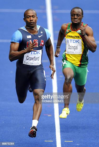 US Shawn Crawford and Zimbabwe's Brian Dzingai compete in the men's 200m round 1 heat 1race of the 2009 IAAF Athletics World Championships on August...