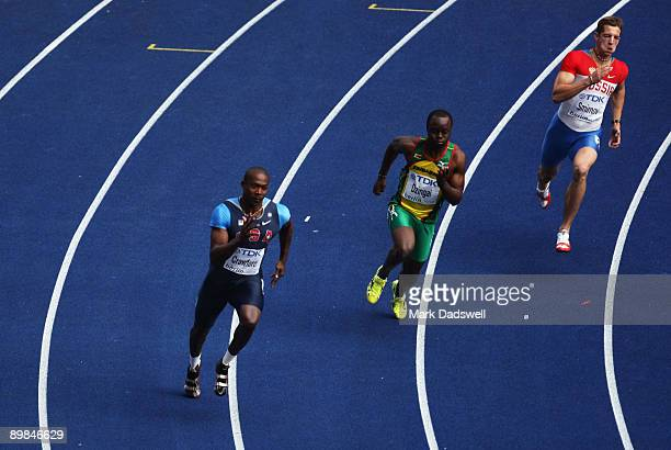 Shawn Crawford of United States Brian Dzingai of Zimbabwe and Roman Smirnov of Russia compete in the men's 200 Metres Heats during day four of the...