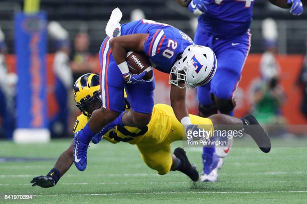 Shawn Davis of the Florida Gators gets tackled by Devin Bush of the Michigan Wolverines int he second quarter of a game at ATT Stadium on September 2...