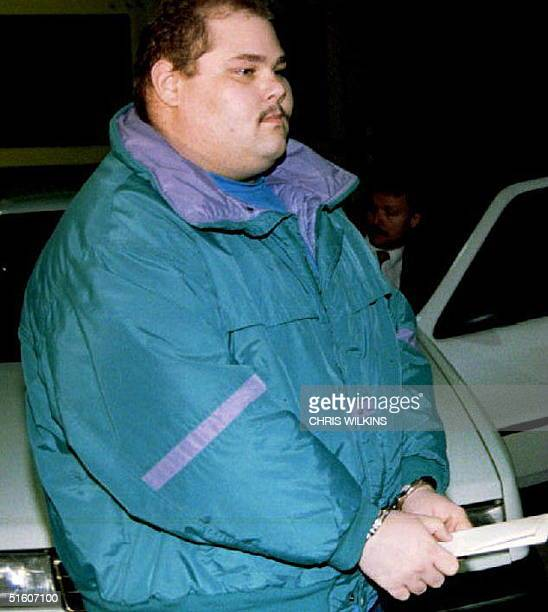Shawn Eric Eckardt bodyguard of figure skater Tonya Harding walks handcuffed into jail after being arrested and charged with conspiracy in the attack...