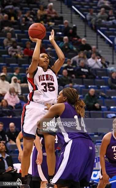 Shawn Goff of Ole Miss shooting over TCU's Lori ButlerRayford in the secondhalf of a firstround game at the Hartford Civic Center in Hartford CT on...