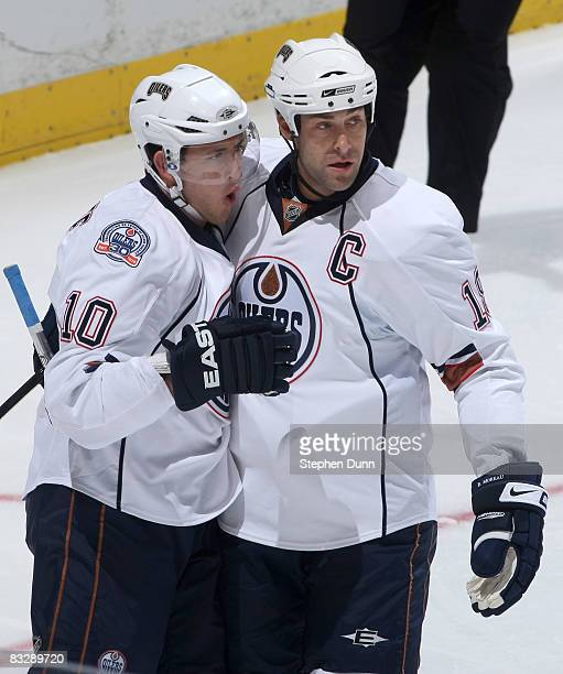 Shawn Horcoff and Ethan Moreau of the Edmonton Oilers celebrate after Horcoff scored a goal against the Anaheim Ducks on October 15 2008 at the Honda...