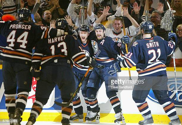 Shawn Horcoff and Ryan Smyth of the Edmonton Oilers celebrate with teammates after scoring the second goal against the San Jose Sharks in game six of...