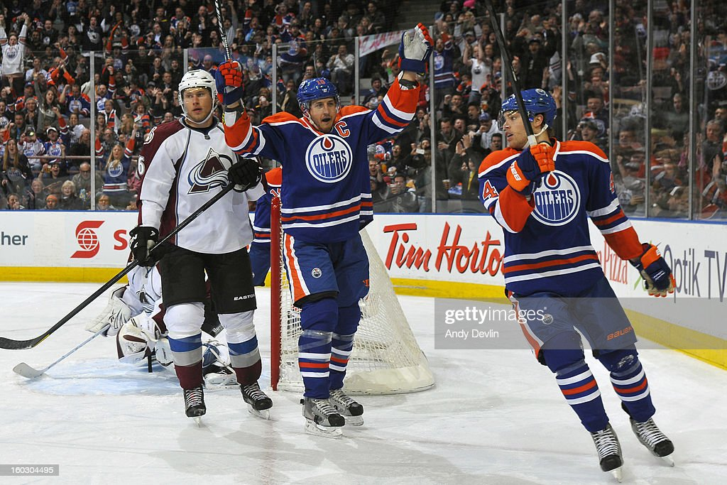 Shawn Horcoff #10 and Taylor Hall #4 of the Edmonton Oilers celebrate after scoring a goal in a game against the Colorado Avalanche at Rexall Place on January 28, 2013 in Edmonton, Alberta, Canada.