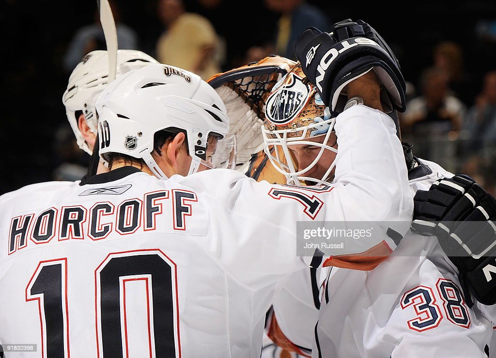 Shawn Horcoff #10 congratulates goalie Jeff Deslauriers #38 of the Edmonton Oilers after defeating the Nashville Predators on October 12, 2009 at the Sommet Center in Nashville, Tennessee.