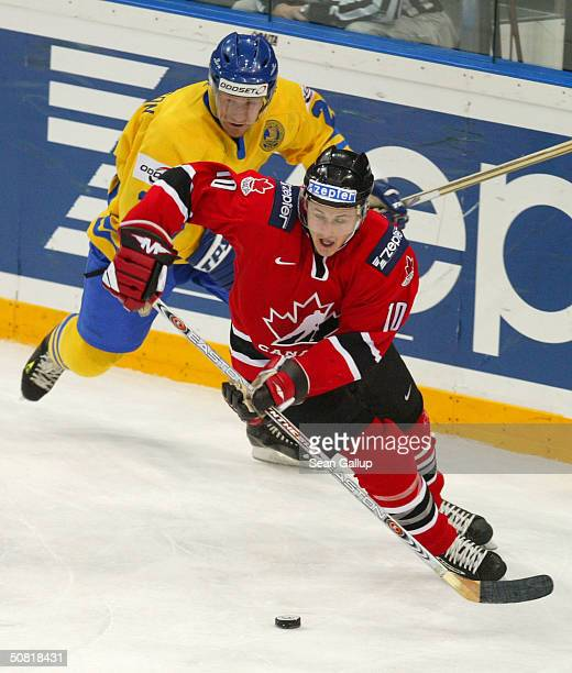 Shawn Horcoff of Canada leads Niklas Andersson of Sweden in the teams' match at the International Ice Hockey Federation World Championship finals May...