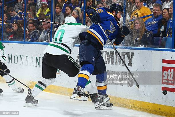 Shawn Horcoff of the Dallas Stars checks Chris Butler of the St Louis Blues off the puck at the Scottrade Center on December 27 2014 in St Louis...